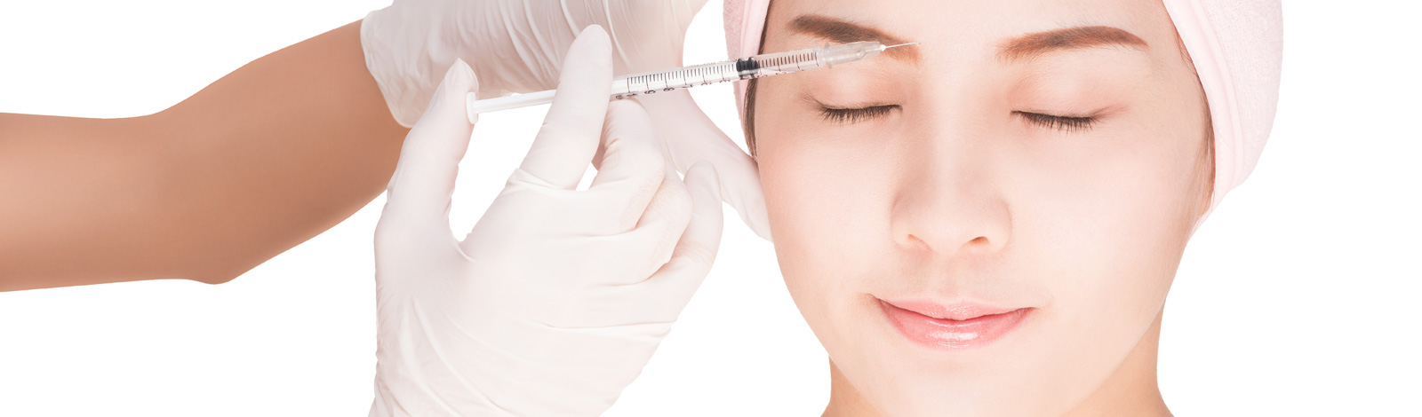 A woman having dermal filler treatment